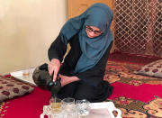 Salgy Baran, 18, who received the highest the highest score in the entire country on Afghanistan's university entrance exams this year, pours tea inside her home in Kabul, Afghanistan, Thursday, Aug. 26, 2021. Baran wants to stay in the country and become a doctor. But as with so many other Afghans, those plans were thrown into doubt when the Taliban rolled into the capital of Kabul earlier this month. (AP Photo/Nillab Burhan)