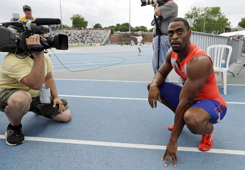 FILE - In this June 23, 2013, file photo, Tyson Gay reacts after winning the senior men's 200-meter dash finals at the U.S. Championships athletics meet in Des Moines, Iowa. Gay failed more than one drug test this year, recording one of his positives at the U.S. championships, where he won the 100 and 200 meters in June, The Associated Press learned on Friday, July 26, 2013. (AP Photo/Charlie Neibergall, File)