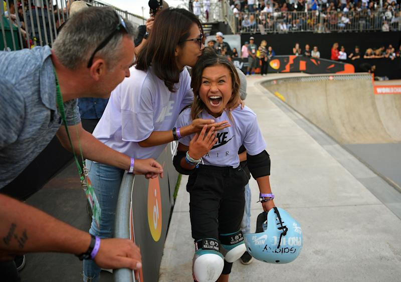 British athlete Sky Brown, 11, reacts as she is kissed by her mother after winning bronze at the World Skateboarding Championships