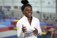 Gymnast Simone Biles answers a question during an interview after a training session Tuesday, May 11, 2021, in Spring, Texas. (AP Photo/David J. Phillip)