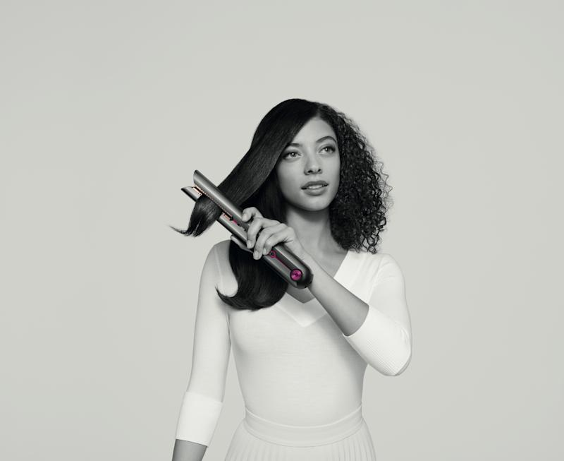 Woman using a Dyson hair straightener