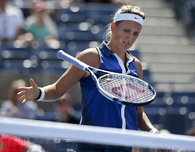 Victoria Azarenka, of Belarus, slams her racket down after losing a point against Ekaterina Makarova, of Russia, during the quarterfinals of the 2014 U.S. Open tennis tournament, Wednesday, Sept. 3, 2014, in New York. (AP Photo/Mike Groll)