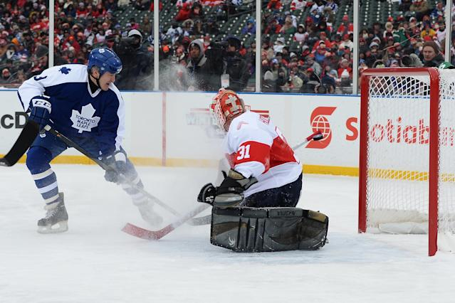 DETROIT, MI - DECEMBER 31: Stew Gavin #9 of the Toronto Maple Leafs scores a goal on goaltender Kevin Hodson #31 of the Detroit Red Wings in the first period during the 2013 Hockeytown Winter Festival Alumni Showdown on December 31, 2013 at Comerica Park in Detroit, Michigan. (Photo by Jamie Sabau/Getty Images)