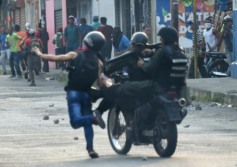 Venezuelan national guards clash with demonstrators at the border town of Urena after Maduro's government ordered to temporary closure of the border with Colombia