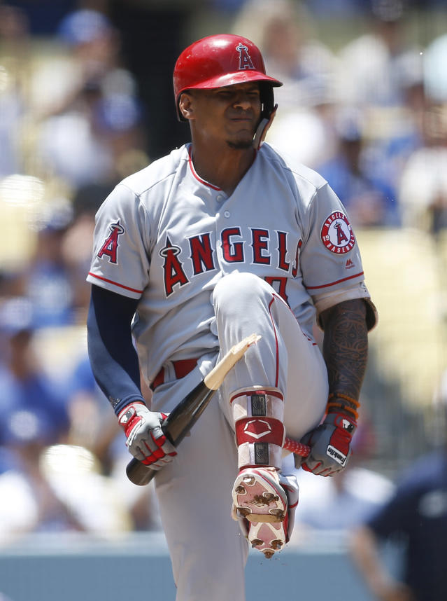 Los Angeles Angels Jefry Marte breaks his bat over his leg after striking out on a full count pitch from Los Angeles Dodgers starting pitcher Clayton Kershaw, not pictured to end the top of the first inning of a baseball game leaving the bases loaded Sunday, July 15, 2018, in Los Angeles. (AP Photo/Danny Moloshok)