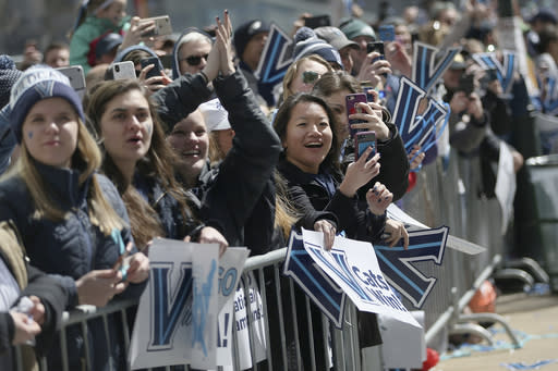 Fans cheer as the players' buses pass by during Villanova's NCAA men's basketball tournament victory parade, Thursday, April 5, 2018, in Philadelphia. (Tim Tai/The Philadelphia Inquirer via AP)