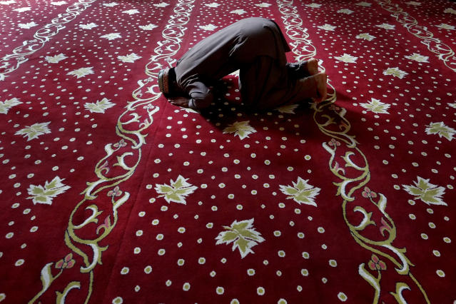 <p>A muslim faithful prays during the Eid al-Adha holiday at the Selimiye mosque, until the 16th century known as the Cathedral of St Sophia, or Agia Sofia, in the Turkish Cypriots breakaway area at northern divided capital of Nicosia, Cyprus, Friday, Sept. 1, 2017. (Photo: Petros Karadjias/AP) </p>