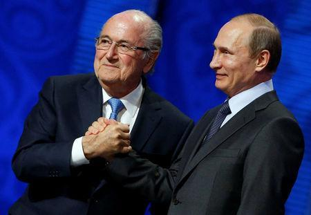 FILE PHOTO: FIFA's President Sepp Blatter shakes hands with Russian President Vladimir Putin (R) during the preliminary draw for the 2018 FIFA World Cup at Konstantin Palace in St. Petersburg, Russia July 25, 2015. REUTERS/Grigory Dukor/File Photo
