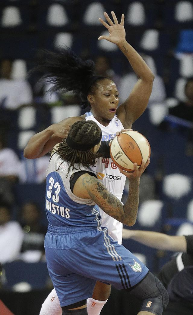 Atlanta Dream's Le'coe Willigham (43) tries to block a shot by Minnesota Lynx' Seimone Augustus (33) during the first half of Game 3 of a WNBA Finals basketball game, in Duluth, Ga., Thursday, Oct. 10, 2013. (AP Photo/John Bazemore)