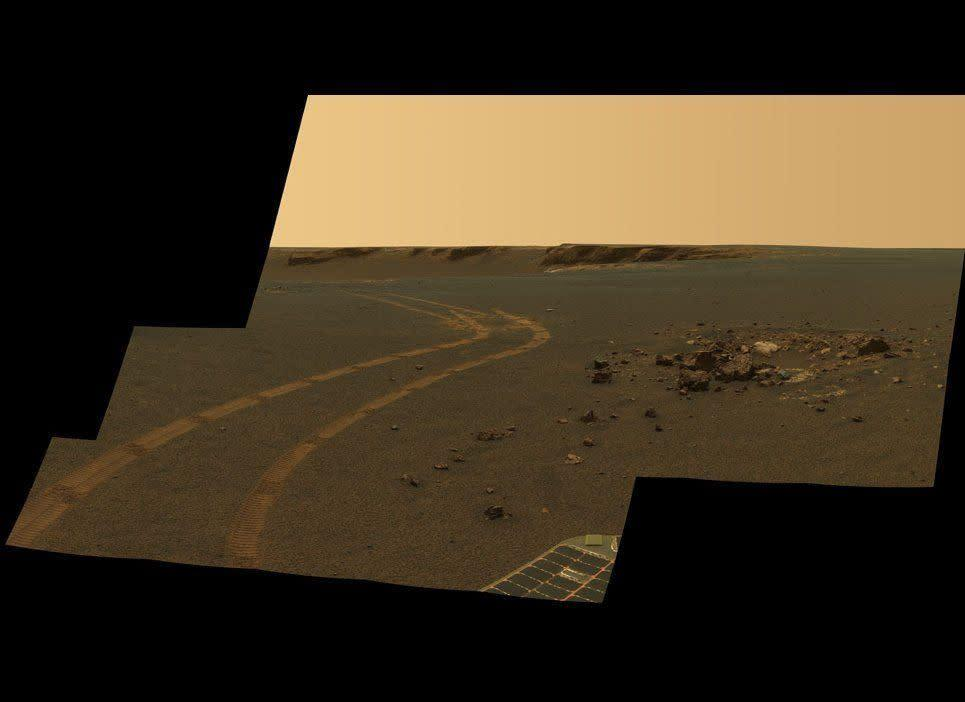 """Having completed the study of Victoria crater in late 2008, Opportunity is now heading towards an even larger crater called Endeavour. Even using new driving methods like the obstacle-avoidance software shown tested here in this sol 1162 (May 2, 2007) Pancam postcard, the rover won't get to Endeavour until sometime in 2011 or maybe even 2012. <em>From """"Postcards from Mars"""" by Jim Bell; Photo credit: NASA/JPL/Cornell University</em>"""