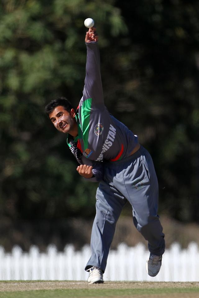 SUNSHINE COAST, AUSTRALIA - AUGUST 11:  Sayed Shiraz of Afghanistan bowls during the ICC U19 Cricket World Cup 2012 match between Pakistan and Afghanistan at John Blanck Oval on August 11, 2012 in Sunshine Coast, Australia.  (Photo by Graham Denholm-ICC/Getty Images)