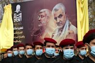 Members of Lebanon's Shiite Hezbollah movement parade in Baalbeck in the eastern Bekaa valley to honour the commanders killed in the US drone strike
