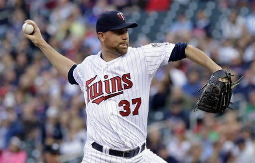 Minnesota Twins pitcher Mike Pelfrey throws against the Baltimore Orioles in the first inning of a baseball game on Friday, May 10, 2013, in Minneapolis. (AP Photo/Jim Mone)