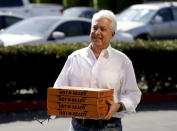 FILE - In this Nov. 6, 2018, file photo, Republican gubernatorial candidate John Cox brings lunch to the offices of Rep. Mimi Walters, R-Calif., in Irvine, Calif. Cox and Caitlyn Jenner, two Republicans running to oust California Gov. Gavin Newsom, sought to make a fresh impression with voters Tuesday, May 4, 2021, with the release of new campaign ads, marking a new phase in the pending recall. (AP Photo/Chris Carlson, File)