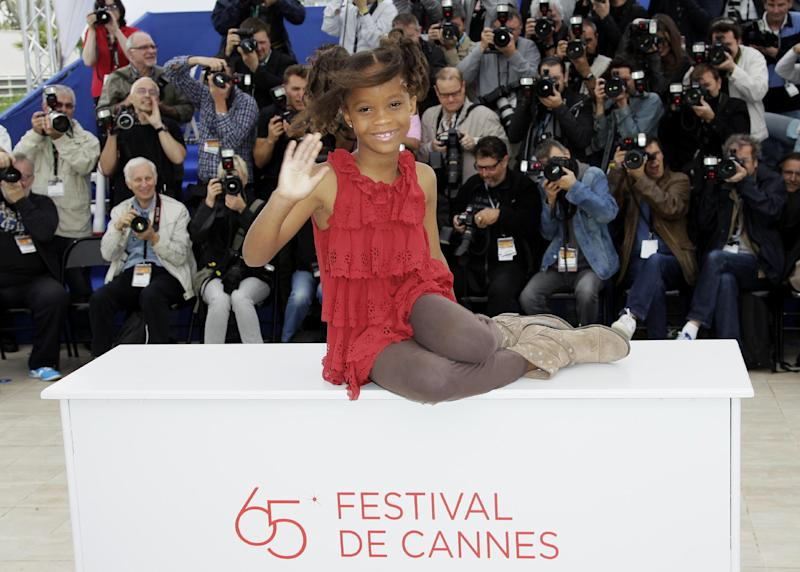 """FILE - In this May 19, 2012 file photo, actress Quvenzhane Wallis poses during a photo call for """"Beasts of the Southern Wild,"""" at the 65th international film festival, in Cannes, southern France. Wallis is an actress of talent, poise and maturity well beyond her years. She was 6 when she played the part of Hushpuppy, and at only 9, she is the youngest-ever best actress nominee at the Academy Awards. (AP Photo/Francois Mori, File)"""