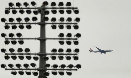 A British Airways plane flies over the Oval Cricket ground