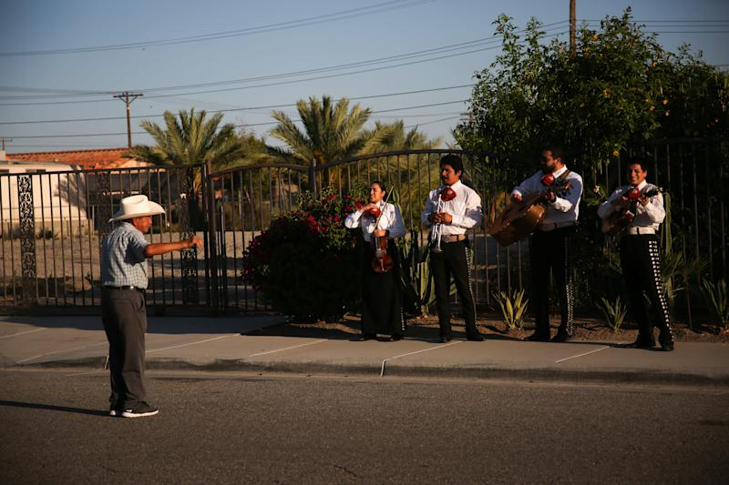 Mariachi Nuevo Amanecer performs while walking through a neighborhood in Mecca, Calif. to spread joy to those at home during the coronavirus pandemic on Sunday, May 17, 2020.