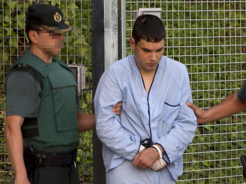 Mohamed Houli Chemlal, suspected of involvement in the terror cell that carried out twin attacks in Spain, is escorted by Spanish Civil Guards to court: AFP/Getty