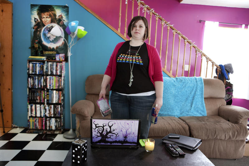 In this March 11, 2011 photo, author Amanda Hocking, left, 26, sits in her home in Austin, Minn. Trying to make it as a writer, Hocking stumbled across a promising new business model for aspiring authors: self-publishing and marketing through e-booksellers. (AP Photo/Robb Long)
