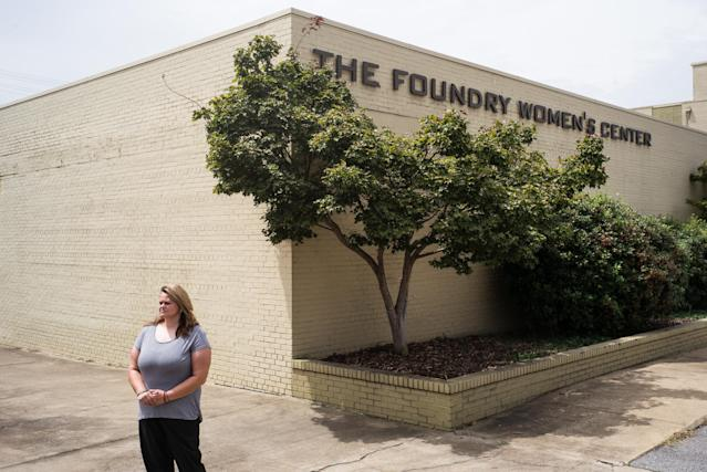 Trinity McGuffie stands outside The Foundry Women's Center. McGuffie hadsubstance abuse disorder and mental health issues for nearly 20 years before she entered The Foundry Ministries' year-long women's recovery program, a faith-based service in Bessemer, Alabama. (Bob Miller for HuffPost)