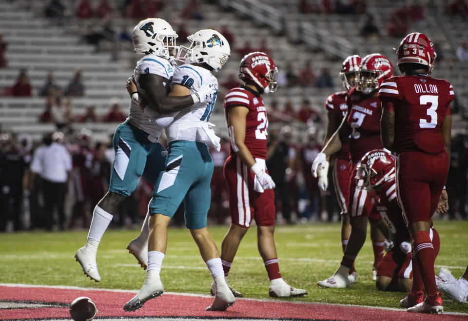 Coastal Carolina running back CJ Marable (1) and quarterback Grayson McCall (10) celebrate after Marable scored a touchdown during the first half of an NCAA football game against Louisiana-Lafayette in Lafayette, La., Wednesday, Oct. 14, 2020. (AP Photo/Paul Kieu)