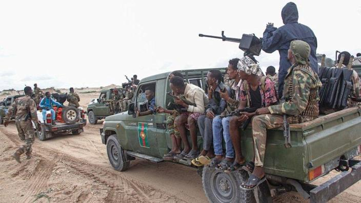 Somali military force members supporting anti-government opposition leaders gather before leaving to their bases in Mogadishu, Somalia, on May 7, 2021