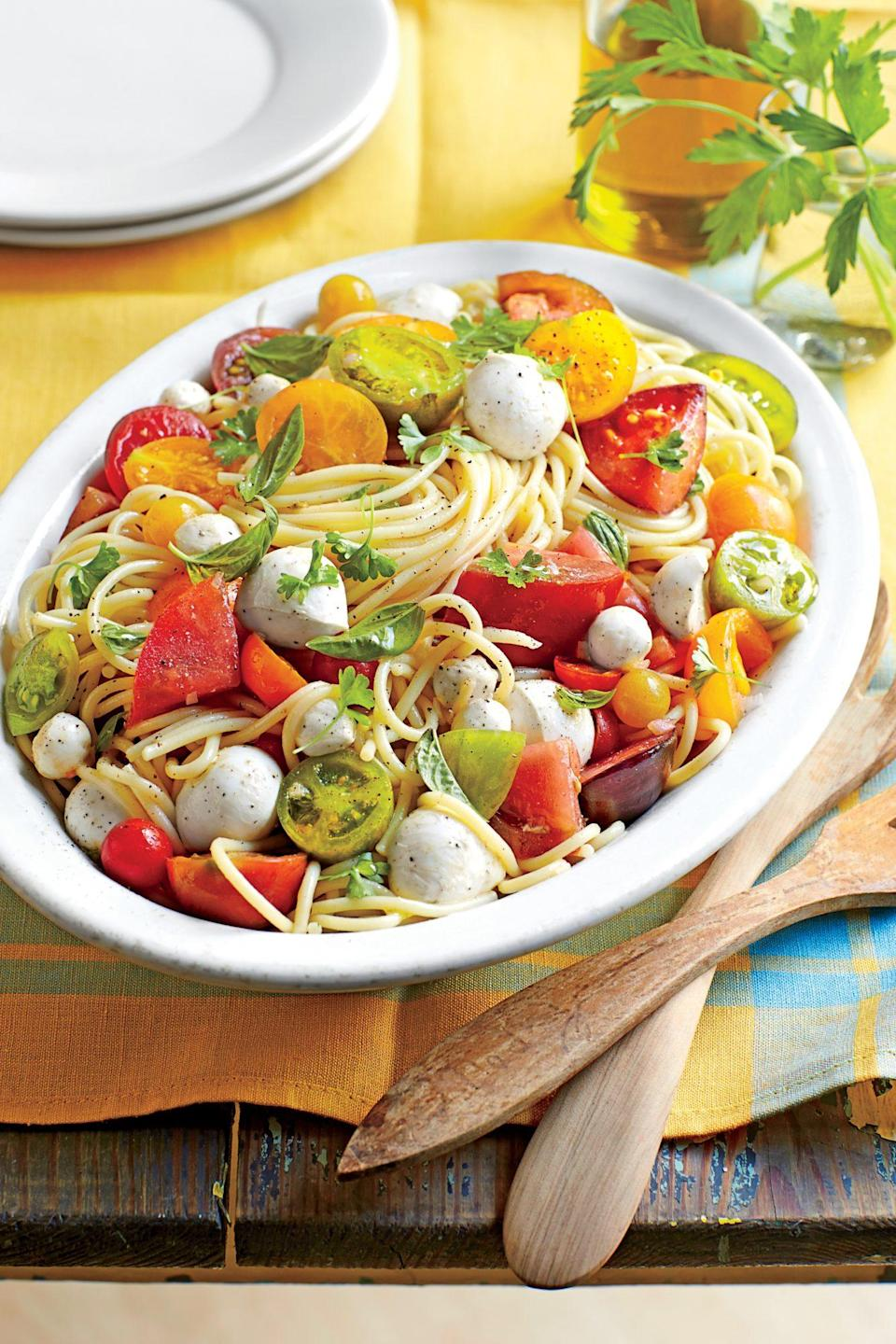 """<p><strong>Recipe: </strong><a href=""""https://www.southernliving.com/syndication/spaghetti-marinated-tomatoes-mozzarella"""" rel=""""nofollow noopener"""" target=""""_blank"""" data-ylk=""""slk:Spaghetti with Marinated Tomatoes and Mozzarella"""" class=""""link rapid-noclick-resp""""><strong>Spaghetti with Marinated Tomatoes and Mozzarella</strong></a></p> <p>You need just a few ingredients to make this colorful and light pasta dinner.</p>"""