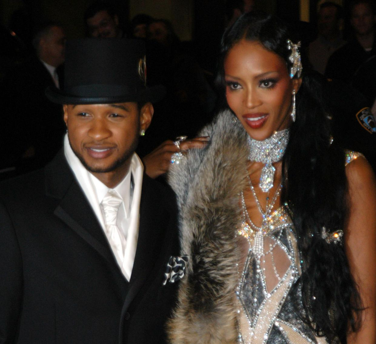 Usher and Naomi Campbell during Usher's 26th Birthday Party at Rainbow Room in New York City, New York, United States. (Photo by Carley Margolis/FilmMagic)