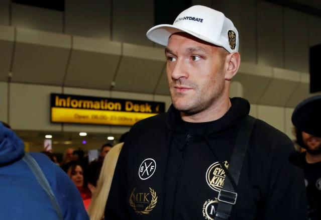 FILE PHOTO: WBC Heavyweight boxing champion Tyson Fury arrives at Manchester Airport, in Manchester