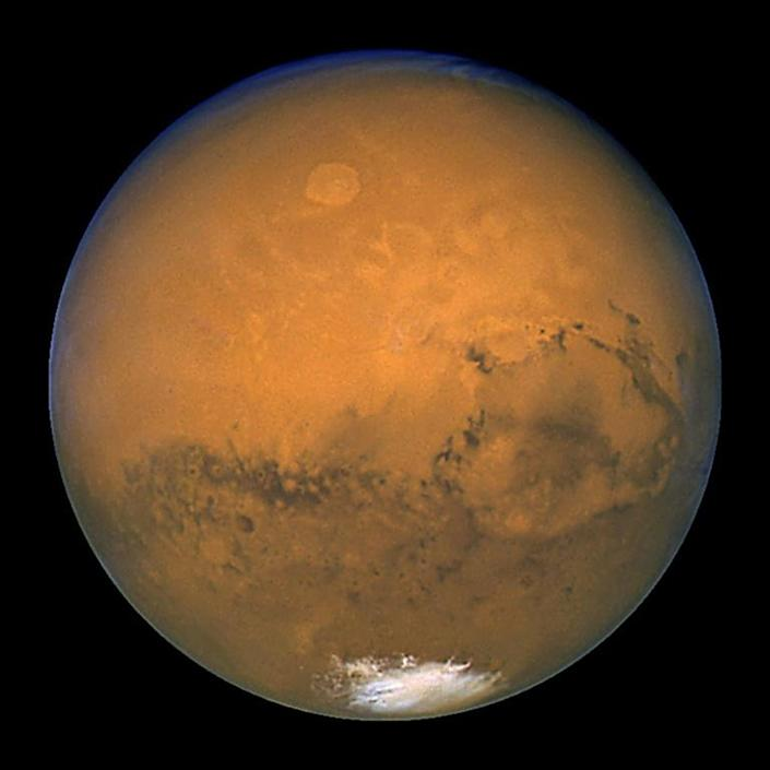 Scientists believe that four billion years ago, Earth and Mars both had the potential to nurture life -- but much of Mars' intervening history is an enigma (AFP Photo/NASA)