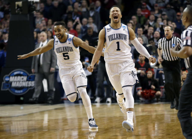 Villanova's Phil Booth, left, and Jalen Brunson celebrate their win over Texas Tech in an NCAA men's college basketball tournament regional final, Sunday, March 25, 2018, in Boston. Villanova won 71-59 to advance to the Final Four. (AP)