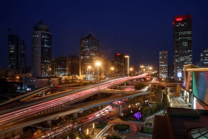 Cars jam a major thoroughfare at evening rush hour in the Central Business District in Beijing