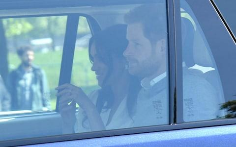 Meghan Markle and Prince Harry arrive for wedding rehearsals in Windsor on Thursday - Credit: Karwai Tang