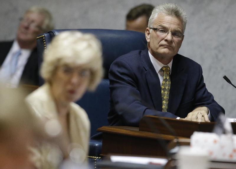 Rep, Kreg Battles, D-Vincennes, listens during a joint House and Senate education committee hearing at the Statehouse Friday, June 21, 2013, in Indianapolis. A legislative study committee listened as CTB/McGraw-Hill President Ellen Haley spoke about what caused close 80,000 students to have their online ISTEP tests disrupted last month. (AP Photo/Darron Cummings)