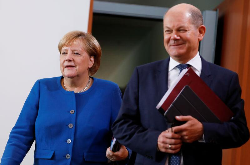 German coalition parties avert government crisis with pension deal