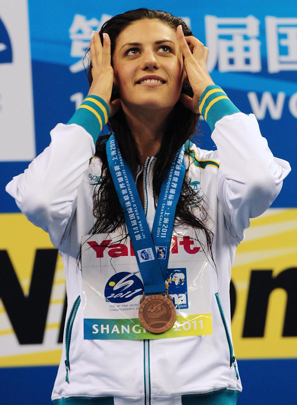 Australia's bronze medalist Stephanie Rice smiles on the podium during the award ceremony for the final of the men's 400-meter individual medley swimming event in the FINA World Championships at the indoor stadium of the Oriental Sports Center in Shanghai on July 31, 2011. (MARK RALSTON/AFP/Getty Images)