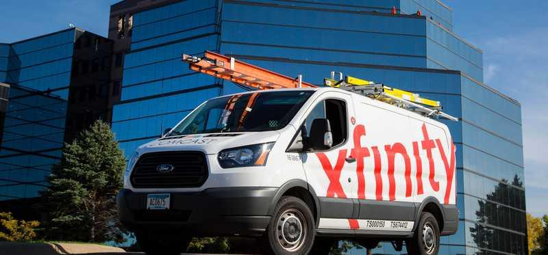 Comcast Xfinity truck in front of Comcast building.