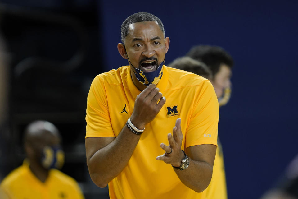 FILE - Michigan head coach Juwan Howard yells at a referee in the second half of an NCAA college basketball game against Toledo, in Ann Arbor, Mich., in this Wednesday, Dec. 9, 2020, file photo. Michigan coach Juwan Howard was honored as The Associated Press men's basketball coach of the year Thursday, April 1, 2021. (AP Photo/Paul Sancya, File)