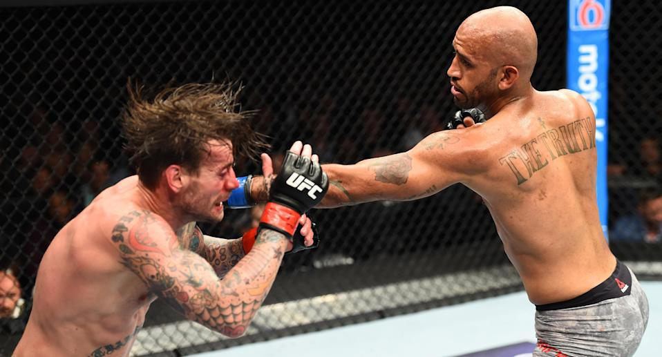 Mike Jackson punches CM Punk in their welterweight fight during the UFC 225 event at the United Center on June 9, 2018 in Chicago, Illinois. (Getty Images)