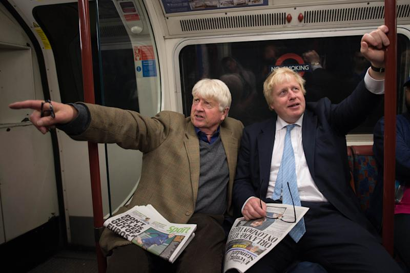 Boris Johnson sits next to his father Stanley (left) on the Bakerloo Line as he bumped into him by chance on the tube train as it left Marylebone Station in London.