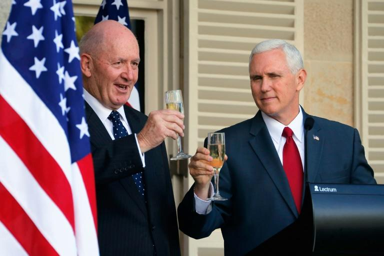 US Vice President Mike Pence (R) and Australia's Governor General Peter Cosgrove toast each other during a lunch reception in Sydney