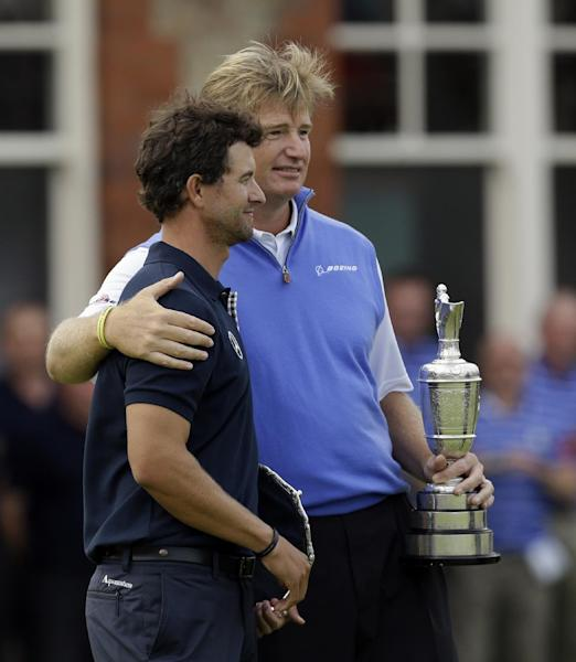 Ernie Els of South Africa holds the Claret Jug trophy after winning the British Open Golf Championship, and stands with Adam Scott of Australia at Royal Lytham & St Annes golf club, Lytham St Annes, England Sunday, July 22, 2012. (AP Photo/Chris Carlson)