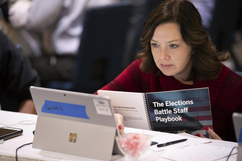 FILE - In this Dec. 16, 2019, file photo, Mandy Vigil, from New Mexico, works during an exercise run by military and national security officials, for state and local election officials to simulate different scenarios for the 2020 elections, in Springfield, Va. It's been more than three years since Russia's sweeping effort to interfere in U.S. elections through disinformation on social media, stolen campaign emails and attacks on voting systems. U.S. officials have made advances in trying to prevent similar attacks from undermining the 2020 vote, but challenges remain. (AP Photo/Alex Brandon, File)