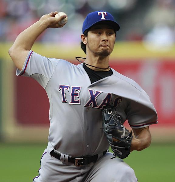 Texas Rangers starting pitcher Yu Darvish throws in the second inning during a baseball game against the Houston Astros, Saturday, May 11, 2013, in Houston. (AP Photo/Patric Schneider)