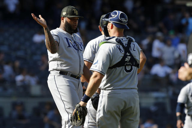 Tampa Bay Rays relief pitcher Jose Alvarado, left, and catcher Erik Kratz celebrate after an 11 inning, 2-1 victory against the New York Yankees in a baseball game, Saturday, May 18, 2019, in New York. (AP Photo/Jim McIsaac)
