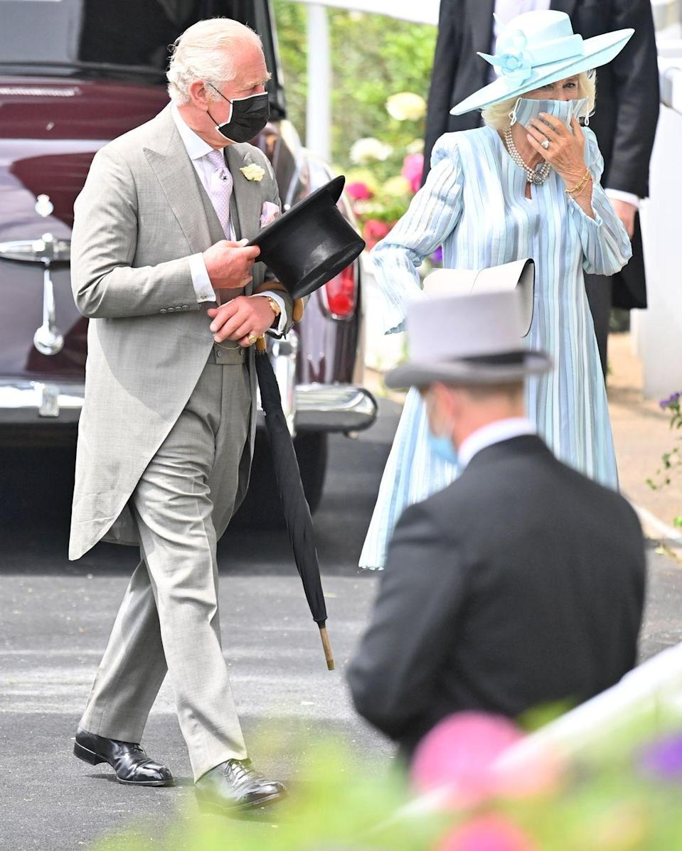 <p>The Prince of Wales and Duchess of Cornwall walking into Ascot Racecourse, all masked up and ready to watch the event.</p>
