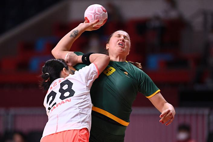 <p>Montenegro's left back Durdina Jaukovic (R) is challenged during the women's preliminary round group A handball match between Japan and Montenegro of the Tokyo 2020 Olympic Games at the Yoyogi National Stadium in Tokyo on July 27, 2021. (Photo by Daniel LEAL-OLIVAS / AFP)</p>