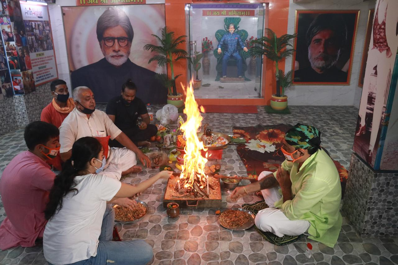 Fans of Bollywood superstar Amitabh Bachchan perform special rituals and prayers for his recovery as he tested positive for COVID-19, in Kolkata ,India on July 12, 2020. Bollywood megastar Amitabh Bachchan, 77, tested positive for COVID-19 on July 11 and was admitted to hospital in Mumbai, with his actor son Abhishek -- who also announced he had the virus -- saying both cases were mild. (Photo by Debajyoti Chakraborty/NurPhoto via Getty Images)