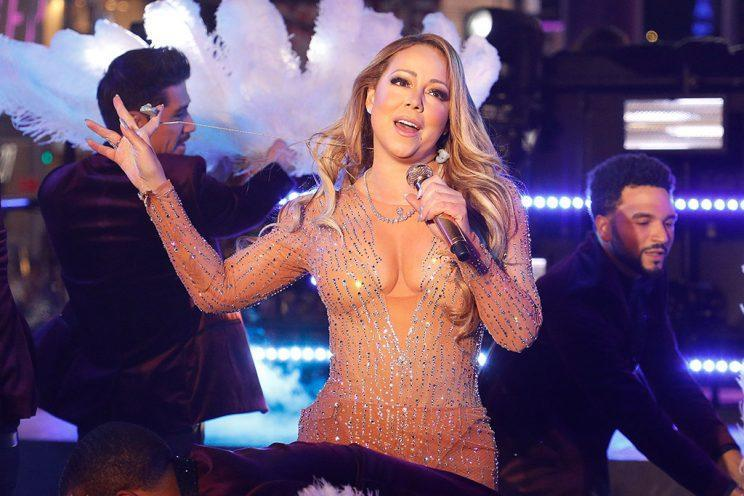 NEW YORK, NY - DECEMBER 31: Mariah Carey removes her earpieces while trying to perform during Dick Clark's New Year's Rockin' Eve at Times Square on December 31, 2016 in New York City. (Photo by Taylor Hill/FilmMagic)