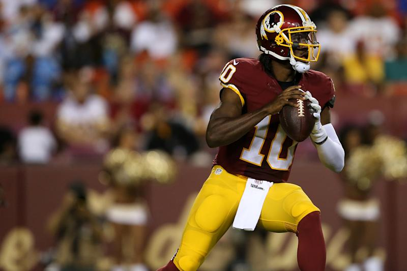 LANDOVER, MD - AUGUST 20: Quarterback Robert Griffin III #10 of the Washington Redskins looks to make a pass during a preseason game against the Detroit Lions at FedEx Field on August 20, 2015 in Landover, Maryland. (Photo by Matt Hazlett/Getty Images)